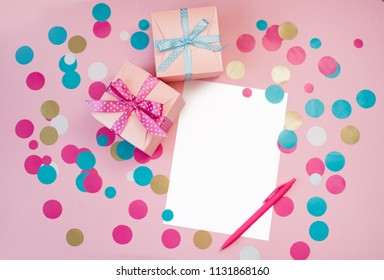 Decorated boxes and blank white sheet of paper as a concept of holiday gifts and congratulations.