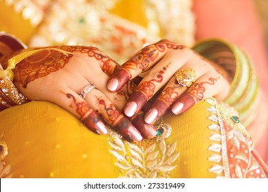 decorated bridal hands with henna