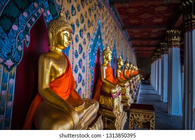 Decorated budha statues in a colourful background. Photo taken in temple in Thailand