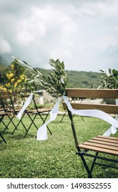 Decorated chairs at a wedding event. Outdoor wedding.