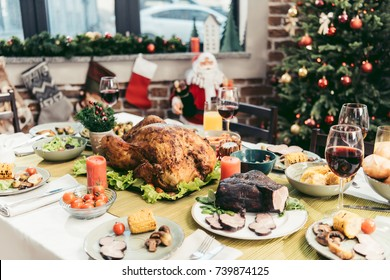 decorated christmas holiday table with delicious assorted dishes