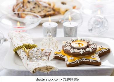 Decorated Christmas table with gingerbread candle