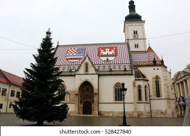 Decorated Christmas tree in front of The Church of St. Mark, landmark in Zagreb, Croatia. Advent in Zagreb Fair was voted as the European Best Christmas Destination for 2016.
