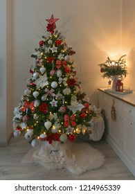 Decorated Christmas tree and gift boxes in living room