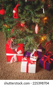 Decorated Christmas tree and Christmas gifts