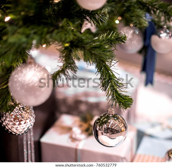 Decorated christmas tree with gifts close up