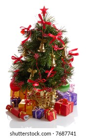 decorated Christmas tree with gold bells and gifts