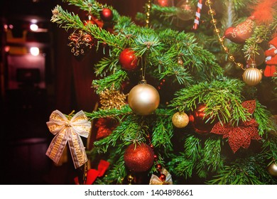 Decorated Christmas tree in golden light