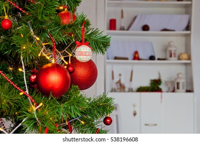 Decorated Christmas tree at home. Close up