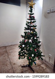 Decorated Christmas tree inside the room