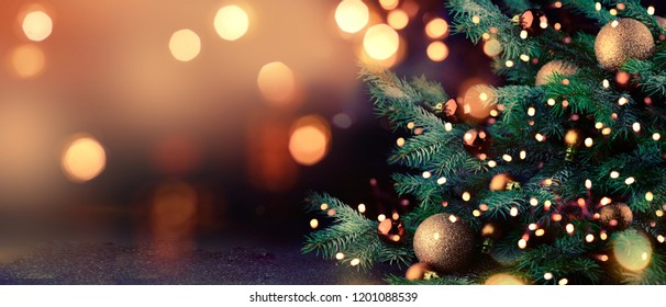 Decorated Christmas tree on blurred background.