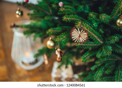 Decorated Christmas tree on blurred background, gift boxes, winter time.