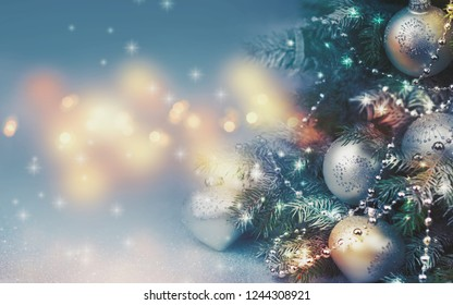 Decorated Christmas tree on blurred background. - Shutterstock ID 1244308921