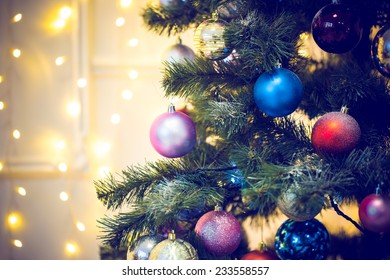 Decorated Christmas tree on blurred backgroun. Blue toned