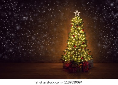 decorated christmas tree on dark background with gifts