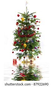 Decorated Christmas tree over white with reflection
