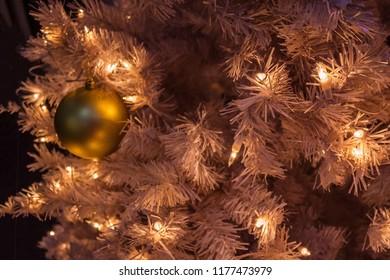 Decorated Christmas tree, preparation for the holiday. Illumination, flickering lights, backlight. Dark background, night.