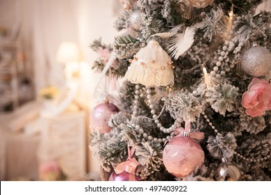 Decorated Christmas tree in rustic and shabby chic style. New Year scene. Close-up