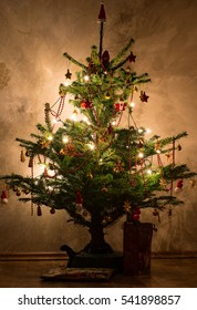 The decorated Christmas tree with stars and Christmas glitter balls