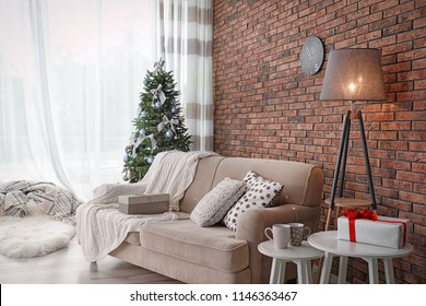 Decorated Christmas tree in stylish living room interior