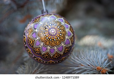 Decorated christmas tree. Zentangle painted new year ball