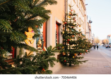 Decorated Christmas trees on the street in Rothenburg ob der Tauber in Germany. Selective focus on a Christmas toy on a branch. Celebration. New Year's decor.