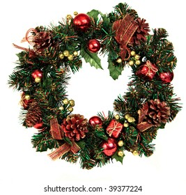 A decorated Christmas wreath with pinecones and ornaments