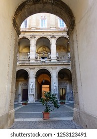 Decorated courtyard and loggia of building Mattei of Jupiter seen froma an arc to Rome in Italy. November 2018.