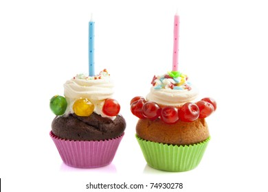 Decorated cupcakes with candles isolated over white