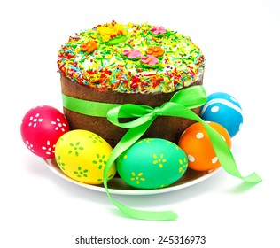 Decorated easter cake and eggs isolated on a white background