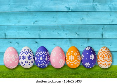 Decorated Easter eggs on green grass. Space for text          - Image