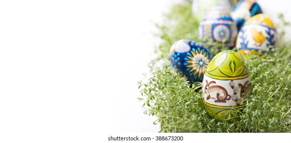 Decorated Easter eggs on green cress, cuckooflower background