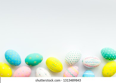 Decorated Easter eggs on white background border copy space