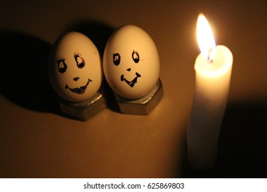 Decorated egg as true lovers at candle light