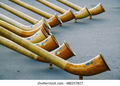 The decorated ends of the alphorns, Switzerland's traditional music instrument.