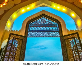 Decorated entrance gate of Grand Mosque in West Bay area, Doha in Qatar. Qatar State Mosque in arab style, Middle East, Arabian Peninsula. Evening sky.