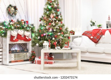 Decorated fireplace in a home with Christmas tree