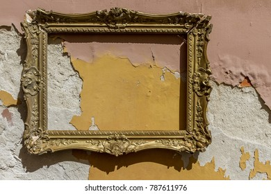 A decorated frame on an ugly wall