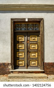 """Decorated frame and panel door at the listed clergy house of the municipal church """"St. Gotthardt"""" in """"Brandenburg an der Havel"""""""