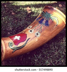 Decorated front part of a Swiss alphorn.