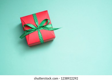 Decorated gift boxes on the green background as a concept of holiday gifts and congratulations.