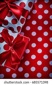 Decorated gifts on polka-dot red table cloth celebrations concep