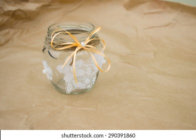 A decorated glass jar on kraft paper background