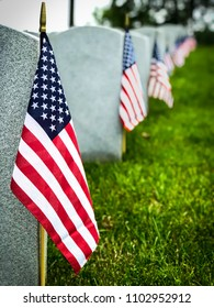Decorated graves of US military service members at a Virginia cemetery.