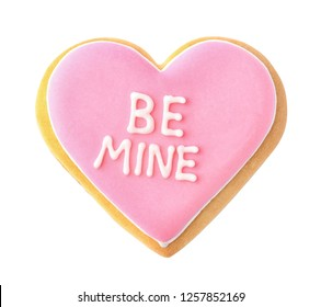 Decorated heart shaped cookie with phrase BE MINE on white background, top view. Valentine's day treat