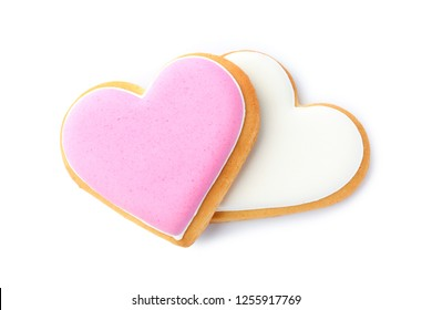 Decorated heart shaped cookies on white background