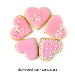 Decorated heart shaped cookies on white background, top view