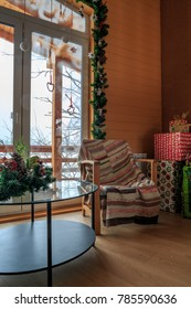 decorated home interior with xmas gifts in  cottage.