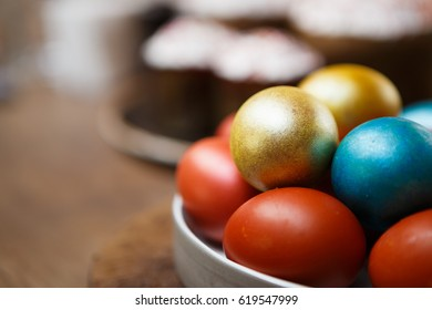 Decorated home made Easter cake & painted colorful chicken eggs for spring Christian Orthodox holiday celebration.Enjoy decorative tasty homemade food