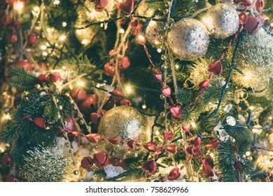 Decorated and illuminated christmas tree. Selective focus, toned image